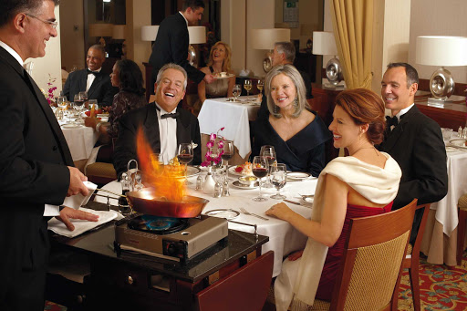 Cunard-Queen-Mary-2-Dining - A traditional flambé dish is prepared for guests in the dining room of Queen Mary 2.
