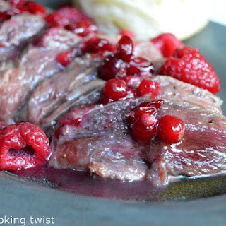 Duck Breasts with a Honey Raspberry & Cranberry Sauce.