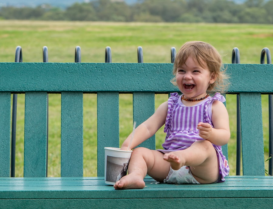 Gia by Geoff Ferrer - Babies & Children Children Candids ( child, laughing, sitting, park, bench, happy, park bench, baby, , public, furniture, object )