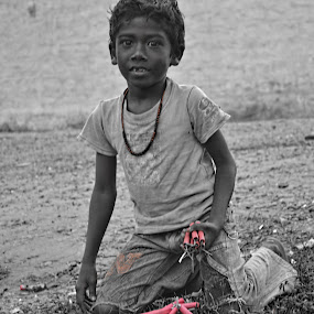 Happiness by Padmanaban Ebbas - People Street & Candids ( helping, poor, happiness, crackers, boy, kid )