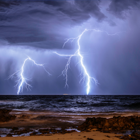Beach flash by Craig Eccles - Landscapes Weather ( thunder, water, clouds, wind, lightning storm, news, electric, waves, beach, storm, lightning, strong, event, wave, power, cloud, thunder storm, rocks, rain )