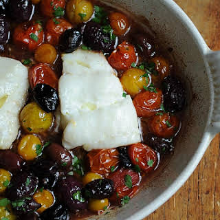 Roast Cod with Little Tomatoes and Assorted Olives.