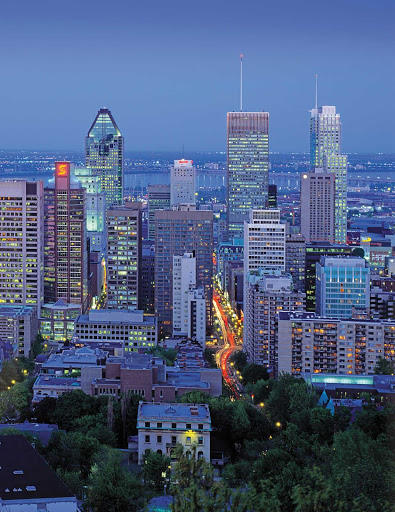 The Montreal cityscape at dusk.