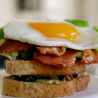 Bacon, Lettuce, Tomato, Avocado and Fried Egg Sandwich.