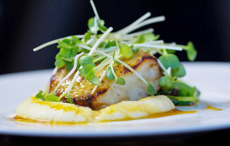 A fish and sprouts entrée at Oasis of the Seas' 150 Central Park, overseen by James Beard Award-winning chef and Miami restaurateur Michael Schwartz.