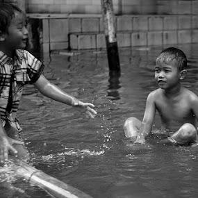 Playing by Jhones Gozali - Babies & Children Children Candids ( candids, street, bw, floods, children )