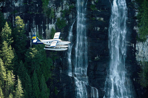 flight-harbour-air-Vancouver-British-Columbia - A Harbour Air Floatplane flies past waterfalls near Vancouver, British Columbia.