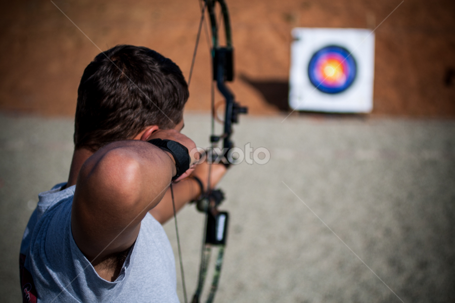 Taking Aim by Werner Booysen - Sports & Fitness Other Sports ( archer, arrow, archery, target, bow, man, werner booysen,  )