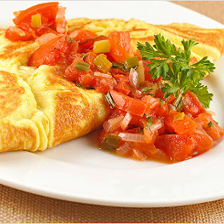 Cheese-Filled Omelets with Tomatoes and Scallions.