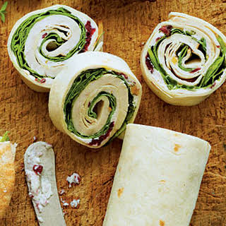 Turkey-and-Spinach Wraps with Cranberry-Walnut-Cream Cheese Spread.