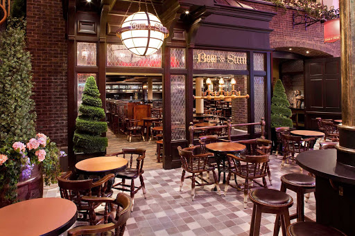 Have a drink, British style, at the Bow & Stern on the Royal Promenade of Allure of the Seas. An English pub with dark wood, nautical decor, live entertainment and an extensive list of brews, it seats 128 and smoking is permitted.