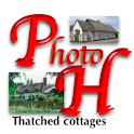 Thatched Cottages Wallpaper logo
