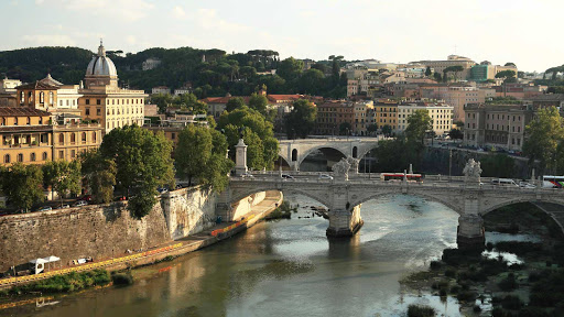 The Tiber River in Rome at sunset.