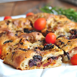 Focaccia with red onion, sundried tomatoes, kalamata olives and Italian herbs