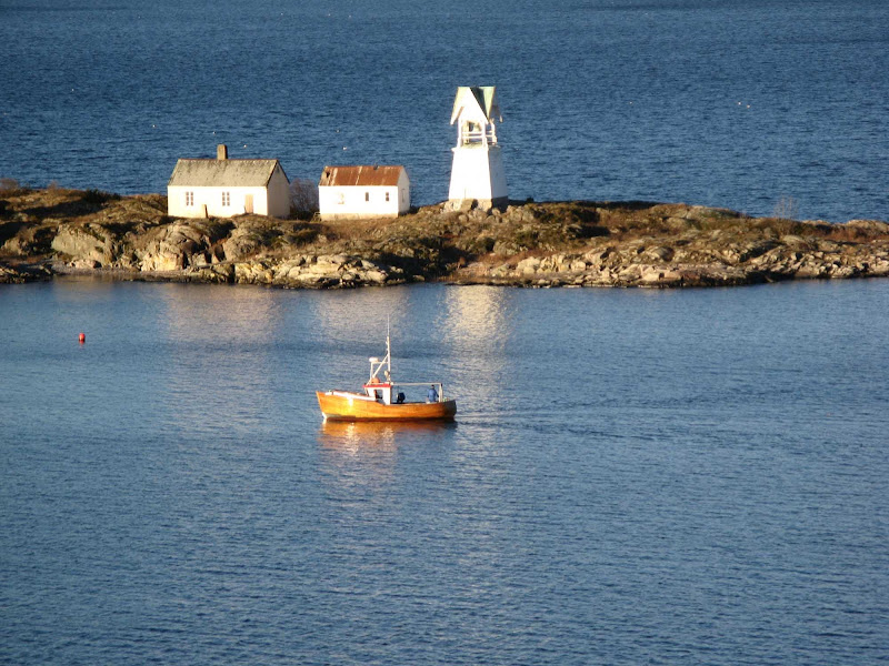 Boat and lighthouse in Oslo Fjord.