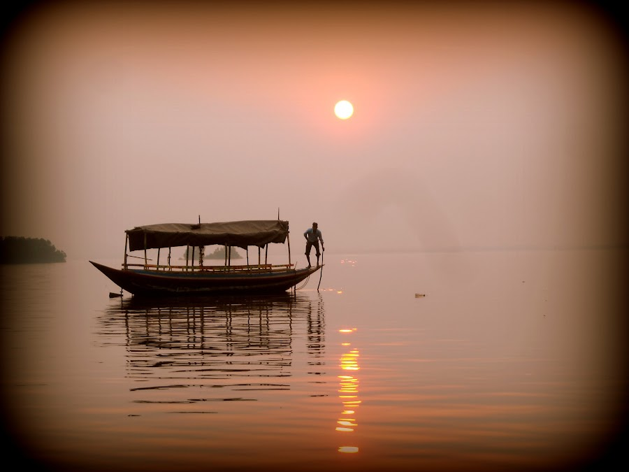 Catching fish in river by Sugata Roy - Landscapes Sunsets & Sunrises ( reflection, sunset, boat, landscape, river,  )