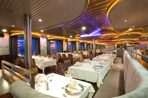 Carnival-Imagination-Spirit-dining-room - You'll have beautiful ocean views and fine meals at the Spirit dining room, one of Carnival Imagination's main dining halls.
