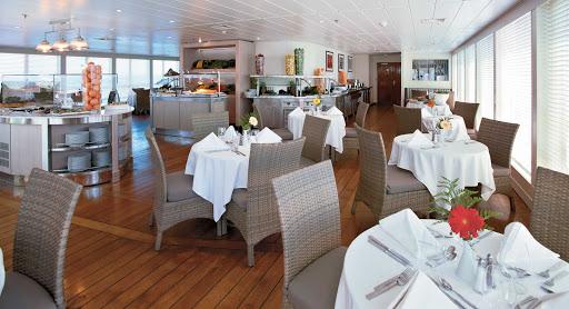 Windstar-Cruises-Wind-Surf-Veranda - At mid-ship, Veranda provides indoor and outdoor dining for breakfast and lunch aboard Windstar Cruises' Wind Surf.