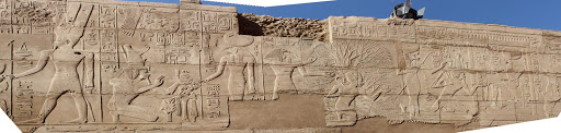 Karnak-Temple-frieze-panorama - A panorama of a frieze depicting pharaohs and other ancient figures in the precinct of Amun in Karnak Temple at Luxor, Egypt. See it as part of a cultural experience aboard Uniworld's River Tosca or Princess Cruises' Pacific Princess.
