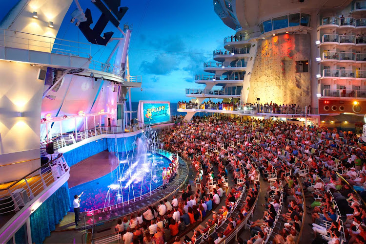 By day, the Aqua Theater aboard Oasis of the Seas is a pool and lounge area. At night it turns into a theatrical venue offering eye-popping water shows and acrobatic performances with seating for 600.