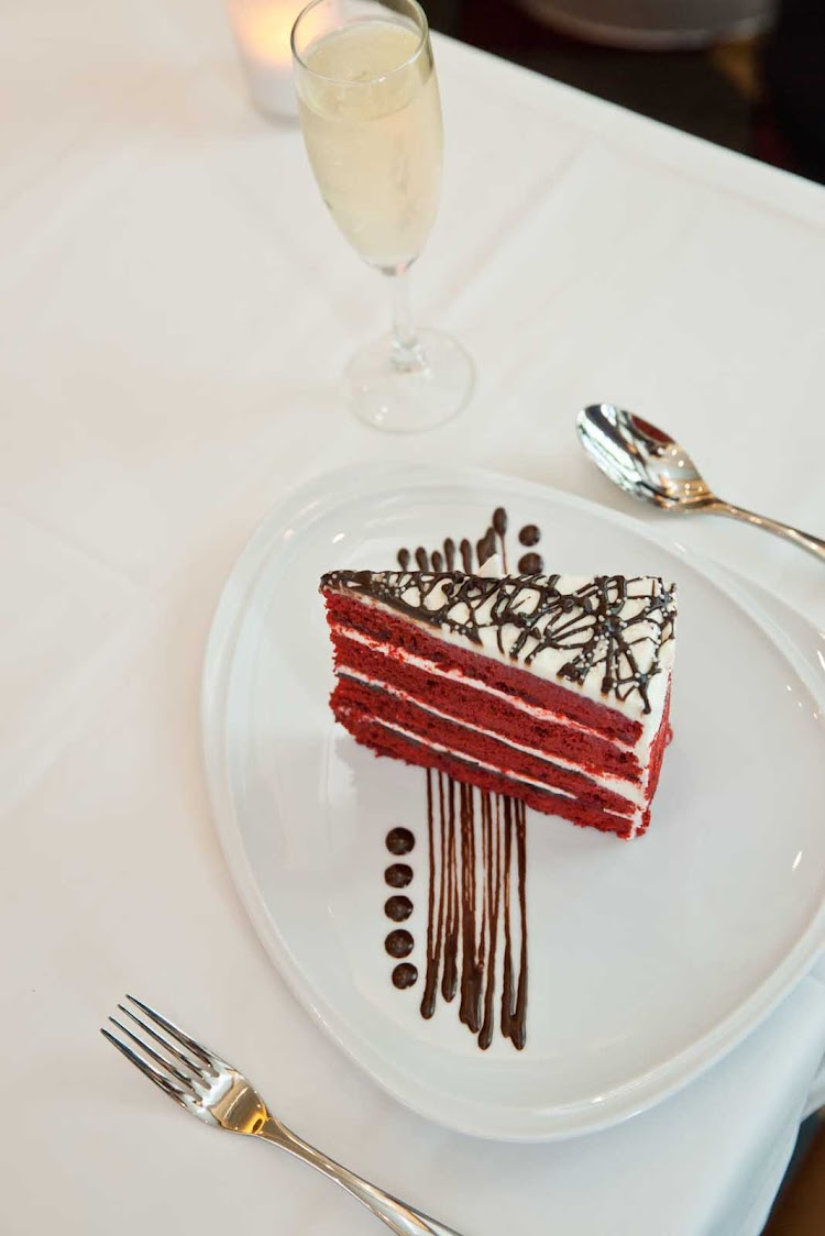 A chocolate-covered strawberry dessert at Chops Grille aboard your Royal Caribbean sailing.