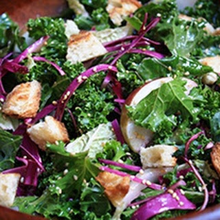 Kale And Cabbage Salad With Soy Vay® Toasted Sesame Dressing And Bialy Croutons.