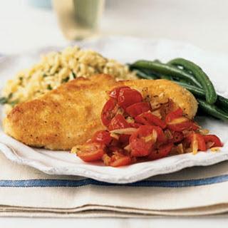 Parmesan Chicken Paillards with Cherry Tomato Sauce.