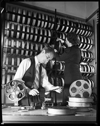 Inspecting film, Department of Education, Film Room, 1937