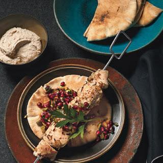 Turkish-Spiced Chicken Kebabs with Pomegranate Relish and Tahini Yogurt.