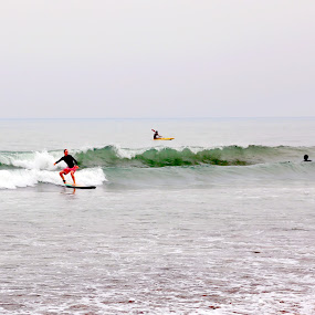 Surfing in Bali by Leong Jeam Wong - Sports & Fitness Surfing ( bali, legian, surfer, waves, sea, beach, board, surf )