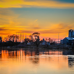 River Sunset by Edwin Montgomery - City,  Street & Park  Night ( cargil, sunset, cargil river, factory, river )