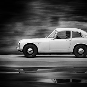 Lookin' at me? by Gerd Moors - Transportation Automobiles ( car, panning, reflection, honda, black and white, white, oldtimer, transportation, black,  )