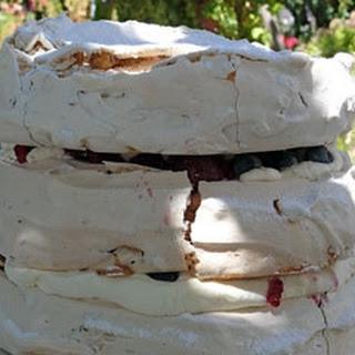 Hazelnut Pavlova Stack With Berries And Cream.