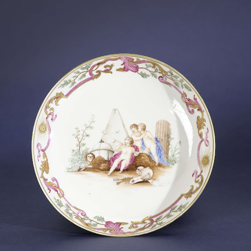 Saucer-dish with a symbolic image of three putti and different objects