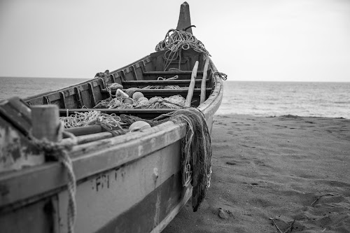 Waiting to sail by Rashmi Rai - Black & White Objects & Still Life ( black & white, boats, sea, kerala, landscape )