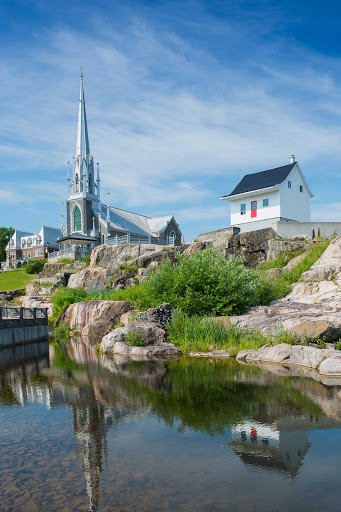 Saguenay-church-Quebec - The Sacre-Coeur church and century-old Little White House in Saguenay, a town on Quebec's Saguenay River, about 125 miles north of Quebec City.