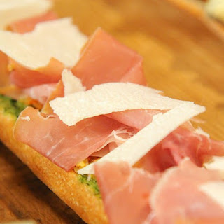 Open-Faced Baguette with Prosciutto and Green Olive Tapenade.