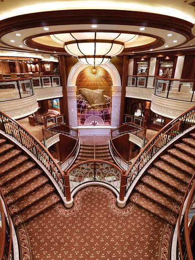 Cunard-Queen-Victoria-Grand-Lobby-2 - The Grand Lobby of Queen Victoria has beautiful triple-height ceilings, a double sweeping staircase and sculpted balconies.