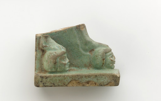 Amulet in the form of a king standing on heads of foreigners