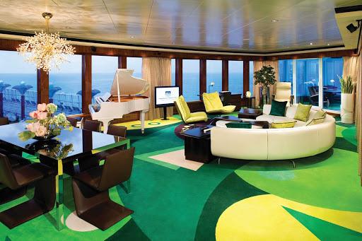 The spacious living room of Norwegian Gem's 3-bedroom Garden Villa even has a piano.