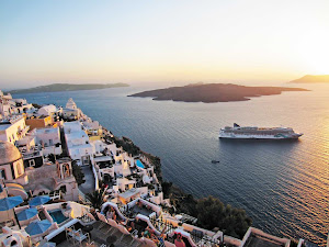 Norwegian Jade stops in the flooded crescent-shaped caldera that forms the interior of Santorini, Greece.