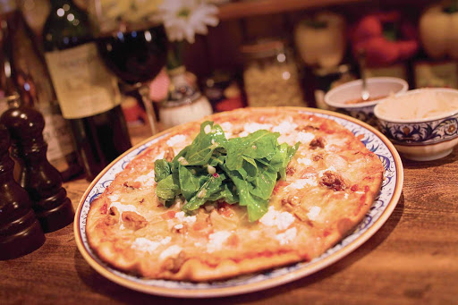 Norwegian-Cruise-Line-dining-LaCucina-pizza - In the mood for authentic Italian pizza? It's a specialty of La Cucina, a popular dining spot aboard your Norwegian Cruise Line vacation.