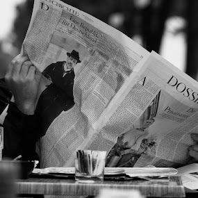 The Newspaper Reader by Matevz Skerget - City,  Street & Park  Street Scenes ( reading, street, newspaper )