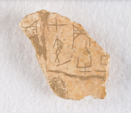 "Inscribed bone fragment (""oracle bone"")"
