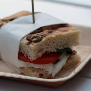 Olive, Rosemary, Anchovy Focaccia, Tomato, Mozzarella Sandwich.