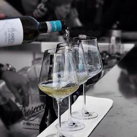 A glass of wine madam ? asked the bartender politely. by Kristian Jøraandstad - Wedding Reception