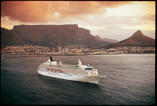 Crystal_Symphony_Capetown - Crystal Symphony sails off the coast of Cape Town, South Africa, at dusk.