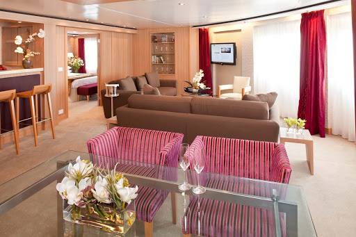 Seabourn_Odyssey_Sojourn_Quest_Signature_Suite-3 - The Signature Suite on Seabourn Odyssey lets you spread out. It has a dining area that fits six people, a private bedroom and bathroom with a large whirlpool tub, a stocked pantry and wet bar, and complimentary wi-fi.