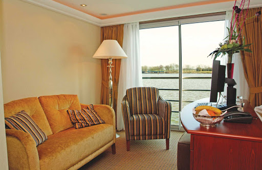 Unwind in the comfort and privacy of your stateroom's lounge on AmaDagio. Staterooms feature plush down bedding, a marble-appointed bathroom, terry robes and slippers, high-speed Internet and first-run Hollywood movies on the flat-panel TV.