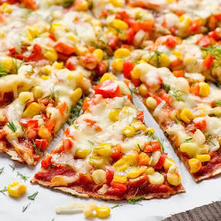 Ezekiel Tortilla Pizza with Corn, Peppers and Garlic Sauce.